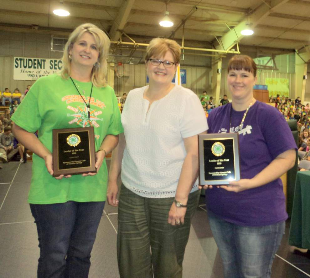 Two Livingston Parish teachers were recognized at the Livingston Parish 4-H Achievement Day as 4-H Leaders of the Year.  Amanda Lavigne, the 4-H sponsor at South Fork Elementary, (pictured left) and Bronwynn Cobb, the 4-H sponsor at North Corbin Elementary, (pictured right) were presented with leadership plaques by Jan Fairchild, president of the Denham Springs Kiwanis Club.