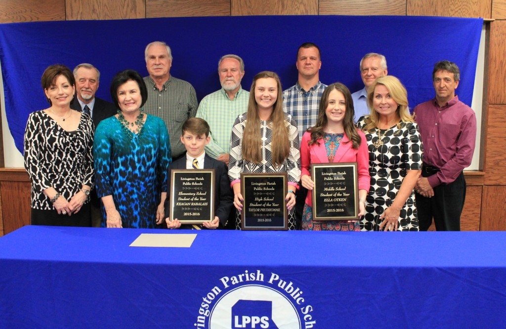 The Livingston Parish Student of the Year winners were honored by the Livingston Parish School Board at a special April 21 ceremony. Pictured, left to right, are: (front row) Livingston Parish School Board members Jan Benton, Karen Wax-Schmitt, Livingston Parish Elementary Student of the Year Keagan Rabalais, Livingston Parish High School Student of the Year Taylor Prudhomme, Livingston Parish Middle School Student of the Year Ella Otken, Kellee Hennessy-Dickerson, (back row) Malcolm Sibley, James Richardson, Sid Kinchen, Buddy Mincey, Jr., Jimmy Watson, and Jeff Cox.