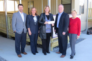Presenting the $5,000 donation to Denham Springs Elementary Principal Gail DeLee, center with check, were State Farm agents, from left, Byron Gill, Joan Landry, Horace Wilkinson and Barbara Smith.  Not pictured are State Farm agents Garris Wilcox and David Brian.)