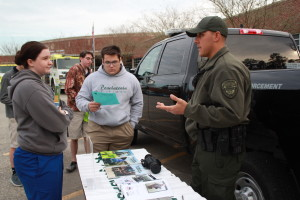 Louisiana Department of Wildlife & Fisheries Enforcement Agent Garrett Kimble, right, talks to Kaitlyn Barnes and Aidan Higginbotham, both seniors at Albany High School, about the education requirements necessary to apply for a job in his field.