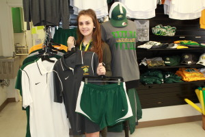 Walker High School Senior Hannah Hernandez, general manager of Walker's school-based enterprise, displays a sampling of clothing that will be featured in the school's new Nike apparel store, Checque Mate.